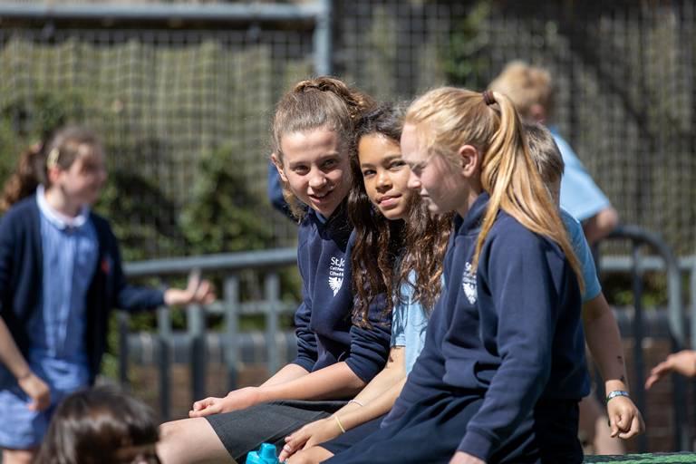 Girls Sitting Together