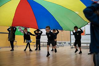 Children Holding Parachute
